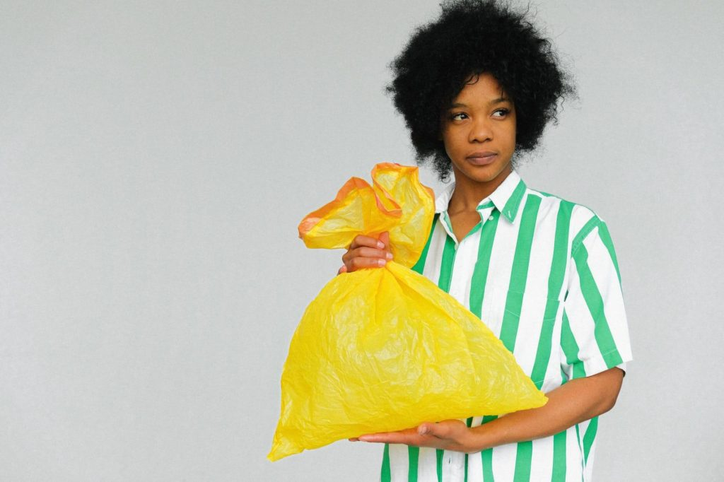 A girl with a garbage bag