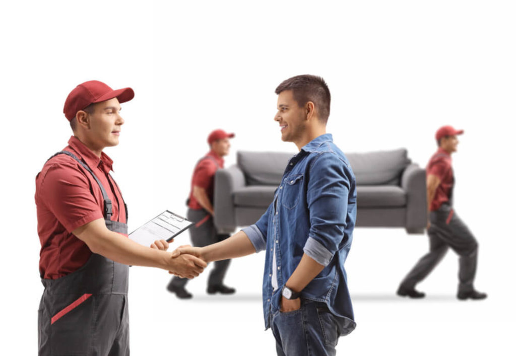 A man shaking hands with a professional mover